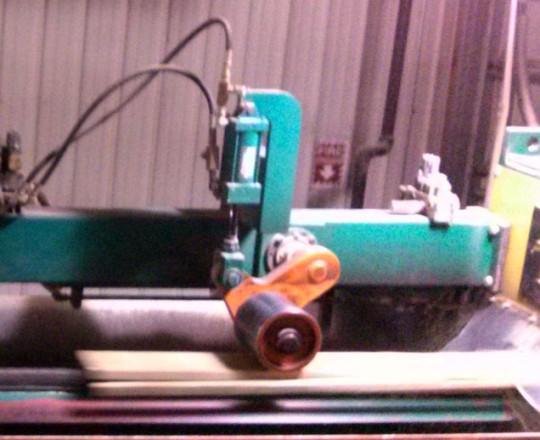 Edger trims off the wane.