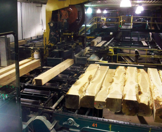 Boards being sliced from logs.