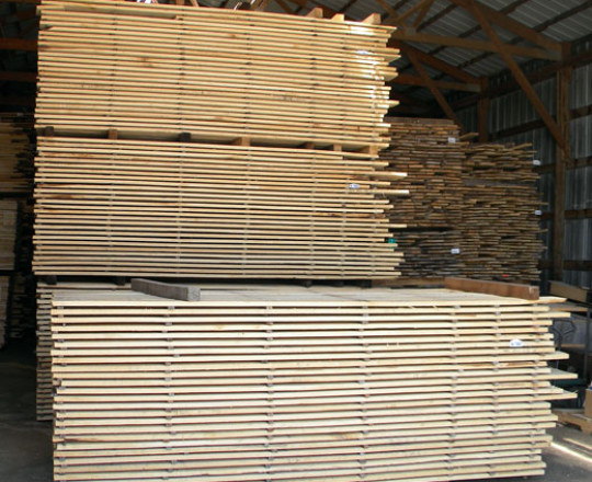 Lumber waiting to be end trimmed