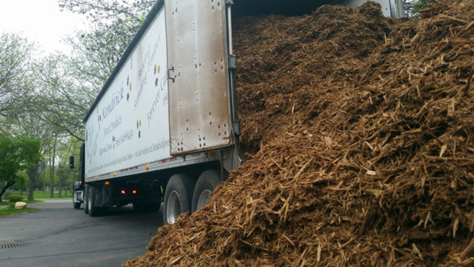 Mulch emptying from walking floor trailer.