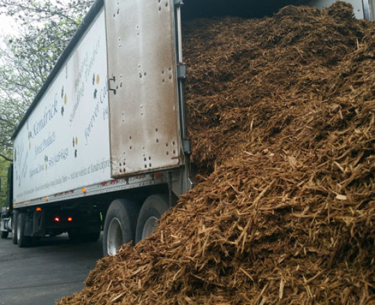 Unloading with walking floor mulch trailer.