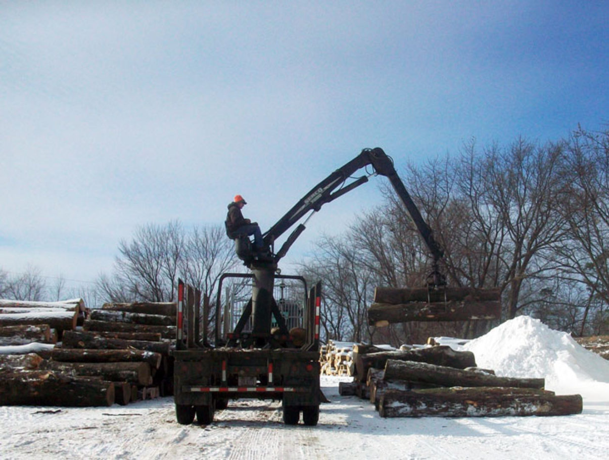 "Josh ""Zippy"" Steger unloading in the log yard."